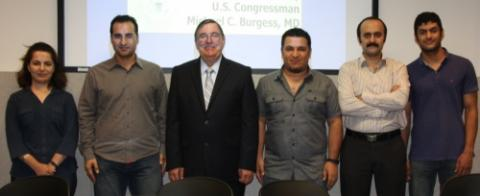 Dr. Takabi and his students with Congressman Michael Burgess